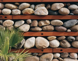 "One of Levine's design experiments is this ""thermal rock wall"" of loosely stacked stones."