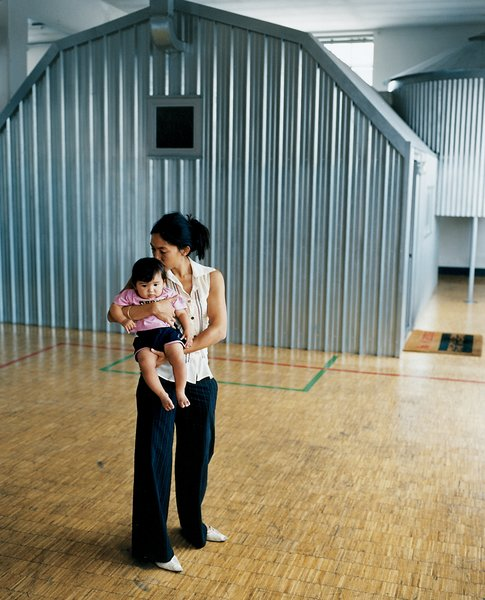 """""""The shape of the house/bedroom [the background for wife Stella and daughter Maria, seen here] is the shape of American farm buildings,"""" Boglione explains."""