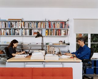 The family that works together stays together: Hachigian and Day at his-and-hers workstations in the shared lower-level study.