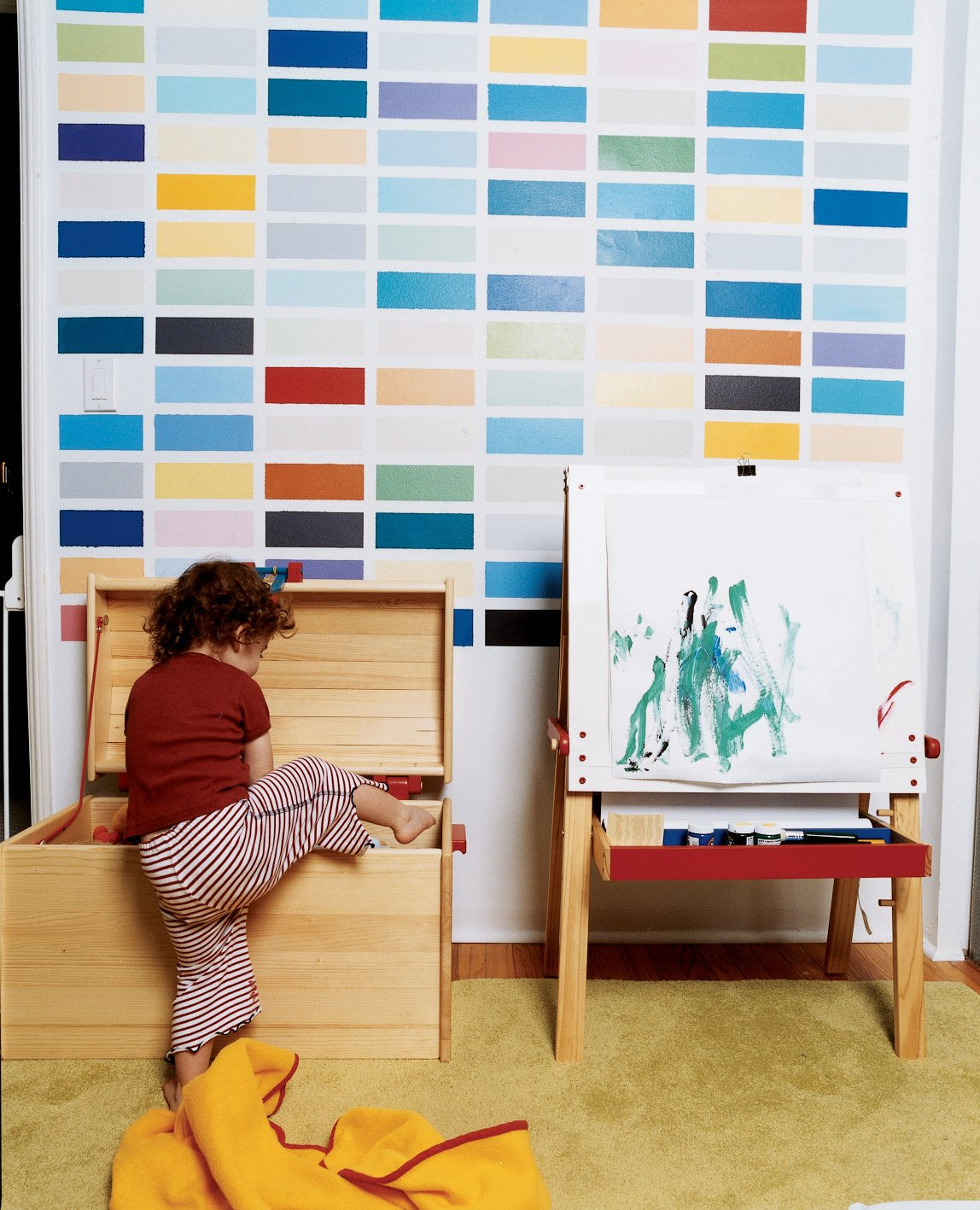 Kids Room, Carpet Floor, Toddler Age, and Playroom Room Type Sosi gets into trouble beneath a colorful grid painted by her dad as a riff on the German painter Gerhard Richter.  Photo 10 of 12 in Way Out West