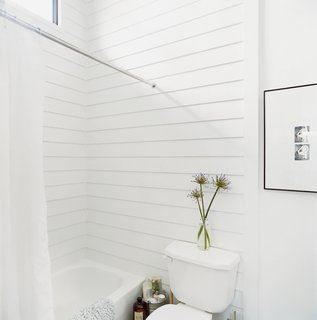 """Byron Mouton of Bild Design combined three distinct interior spaces on one oversized urban lot in New Orleans to create his own home. In the bathroom, unexpected materials, such as a cement board shower surround, were often cheaper and easier to install than more traditional ones. """"We made design decisions based on what we knew was easily available,"""" Mouton recalls. """"The trick was to assemble these materials to express qualities that aren't normally evident."""" Read the entire article here."""