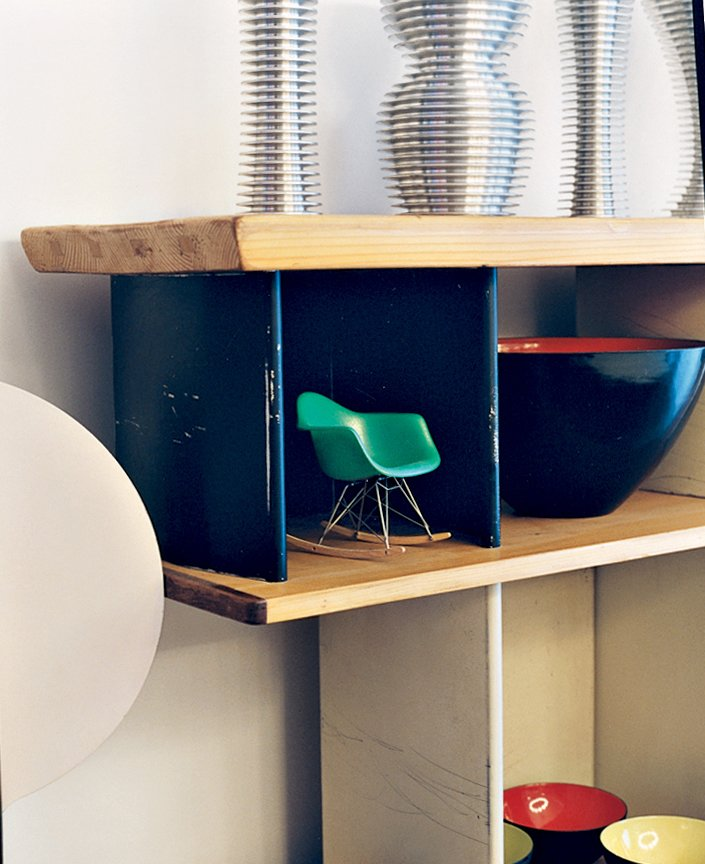 A miniature Eames rocker nestles in a Charlotte Perriand bookcase.  Photo 2 of 14 in Like a Kid in a Candy Store