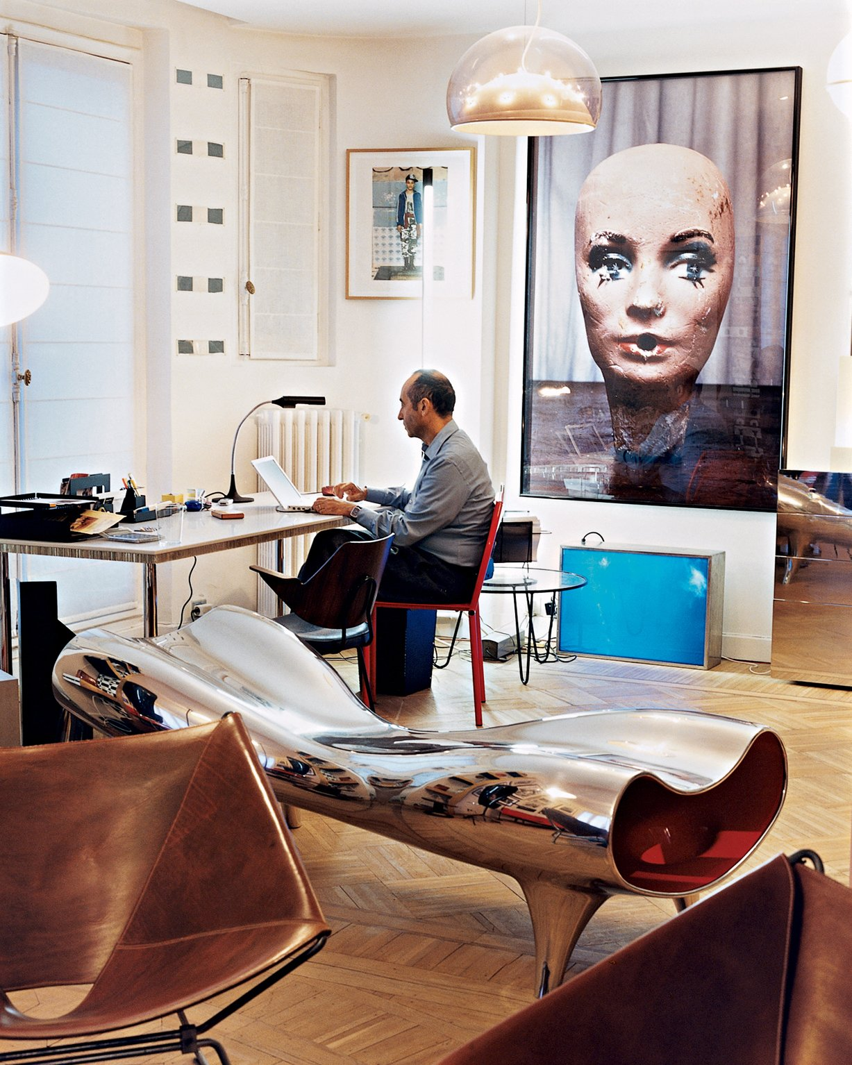 Krzentowski, who works from home for three hours a day, at his desk. A Marc Newson Orgone stretch lounge occupies the foreground, while a large Paul McCarthy photograph looms behind.  Photo 8 of 14 in Like a Kid in a Candy Store