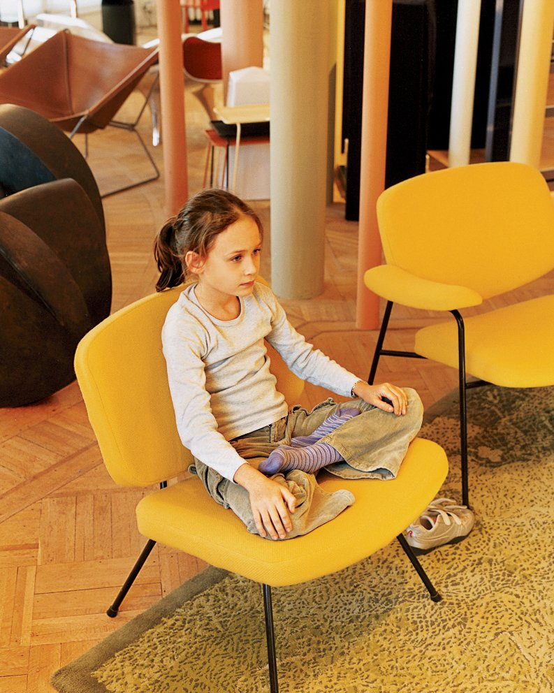 Clara strikes a yoga pose on a vintage Pierre Paulin chair for Artefort.  Photo 9 of 14 in Like a Kid in a Candy Store