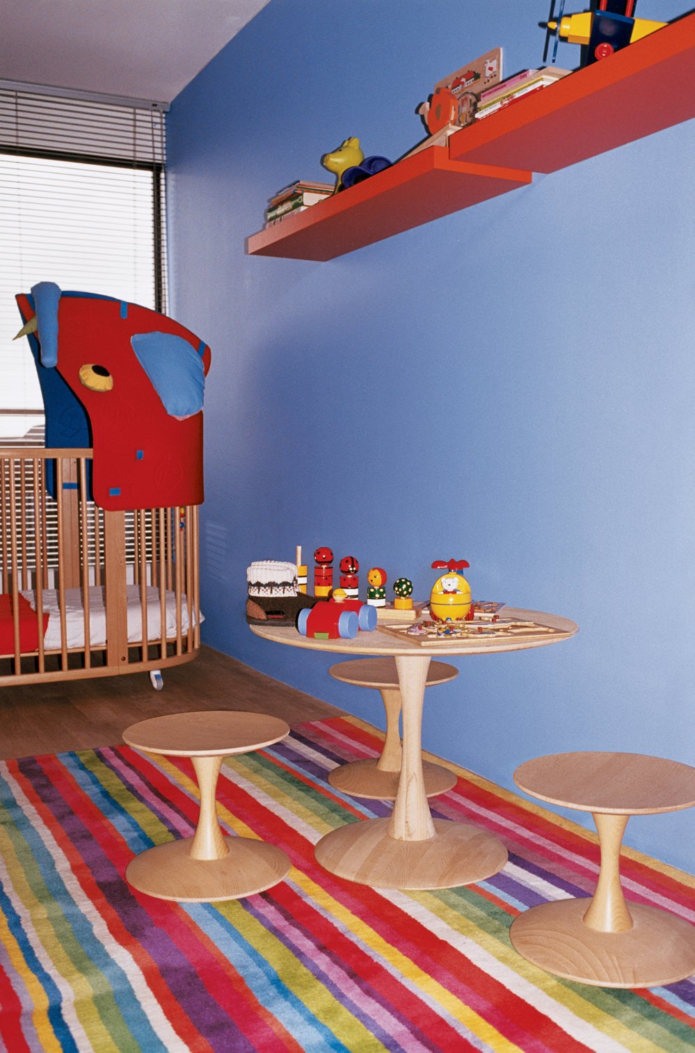 Kids Room and Bedroom Room Type Evidence of the children's burgeoning furniture collection is found in their room, which features an Eames Hang-It-All (not shown) and a bed/crib by Stokke.  Photo 13 of 20 in 20 Cool Cribs for the Modern Baby from Furniture Fascination