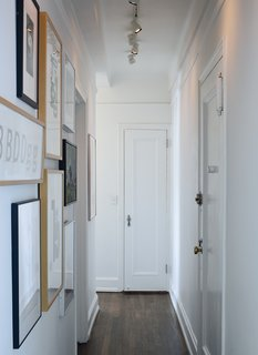 A narrow hallway, typical of prewar apartments, doubles as an art gallery lined with woodcut type studies by graphic artist Jack Stauffacher, type sketches by Erik Spiekermann, and photography by Catherine Opie and Catherine Ledner.