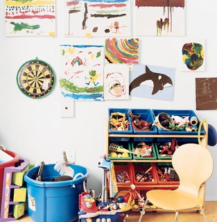 """Six-year-old Mateo's bedroom, which he calls his """"office,"""" provides an interesting contrast to his parents' orderly space. His talents are evident in his paintings, including """"Dalmation"""" (a white sheet of paper with a single black dot in the center)."""