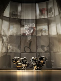 Rendering of the Ron Arad: No Discipline exhibition, featuring Lolita chandelier and Even the Odd Balls? chairs<br><br>Photo courtesy of <br><br>Ron Arad Associates and the Museum of Modern Art