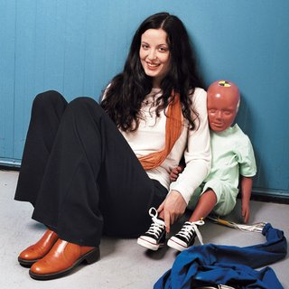 She's No Dummy - Photo 2 of 2 - Laura Thackray, a mechanical engineer for Volvo, with a traditional crash-test dummy. Thackray developed the world's first virtual pregnant crash-test dummy, Linda (illustration below).