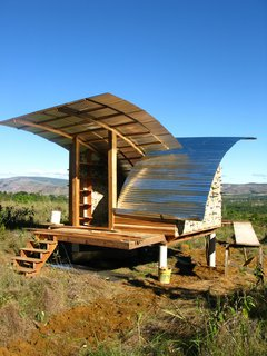 An architectural idealist, Kristofer Nonn answered an online job posting for an ecological builder in Venezuela. The result of his short tenure in the country is two elegantly simple housing shelters. Zinc-corrugated roofing was used to cover the shelters, providing shade and preventing rain from collecting and causing structural deterioration.