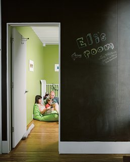 "The wall outside Eli's room is covered with chalkboard paint, adding another method by which to leave messages around the magnetic house. The room measures in at just under 7.5 by 14 feet. ""It was extremely necessary at some point to confront the constraints of the containers,"" Robertson says."