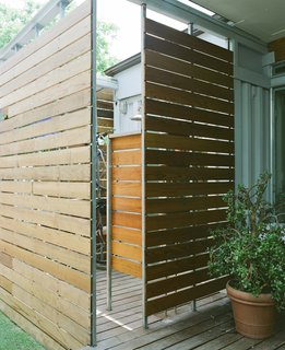 The outdoor shower can be accessed through the master bathroom or from the back porch, which is nice after a long bike ride on a hot Houston day--especially since the couple stores several of their nine bikes inside the walled-off shower space.