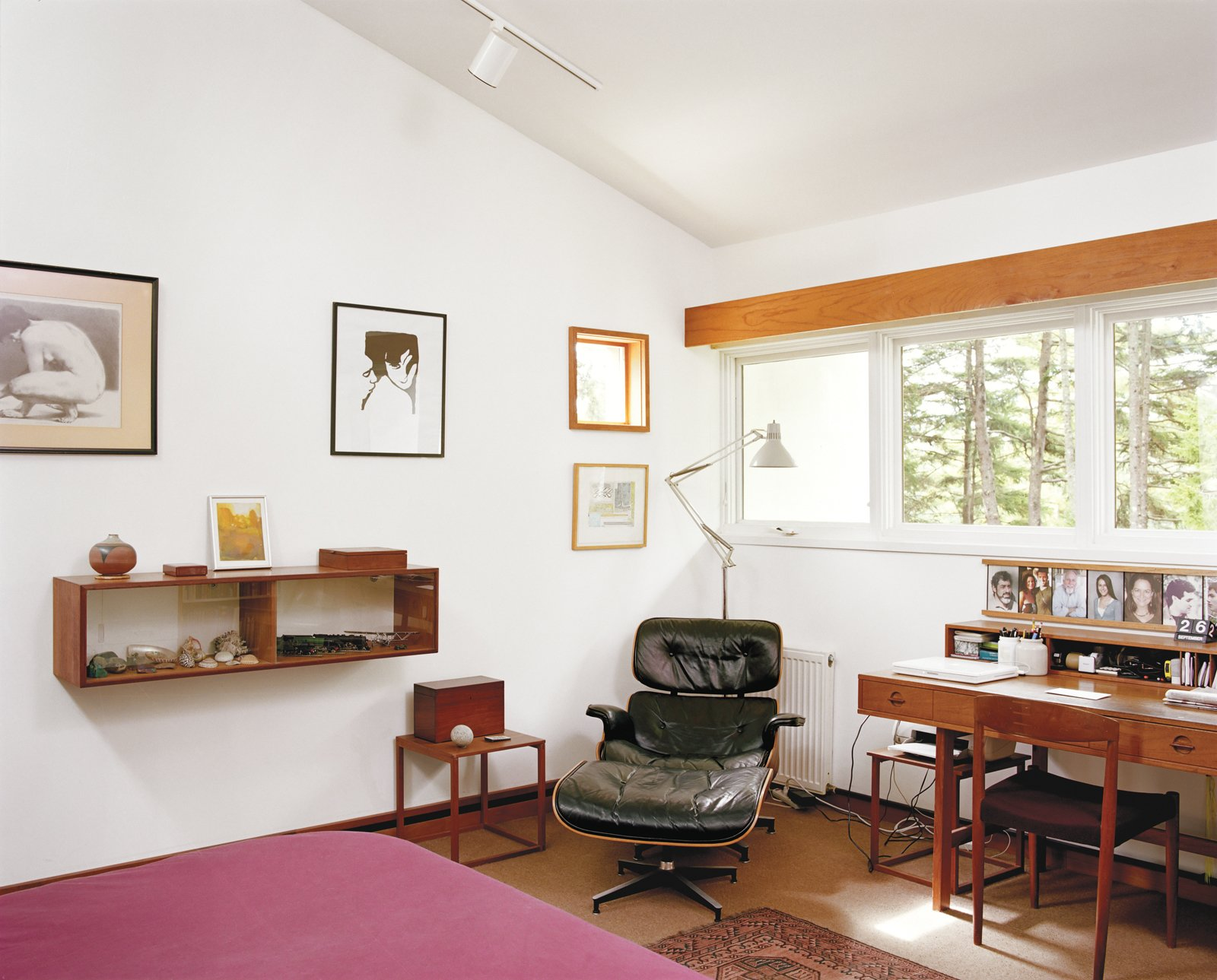 Bedroom, Chair, Bed, Rug Floor, and Track Lighting Classic mid-century furniture like the Eames lounge chair in Cohen's bedroom populate the home, a nod to his long life in architecture.  Photo 9 of 15 in The Right Track