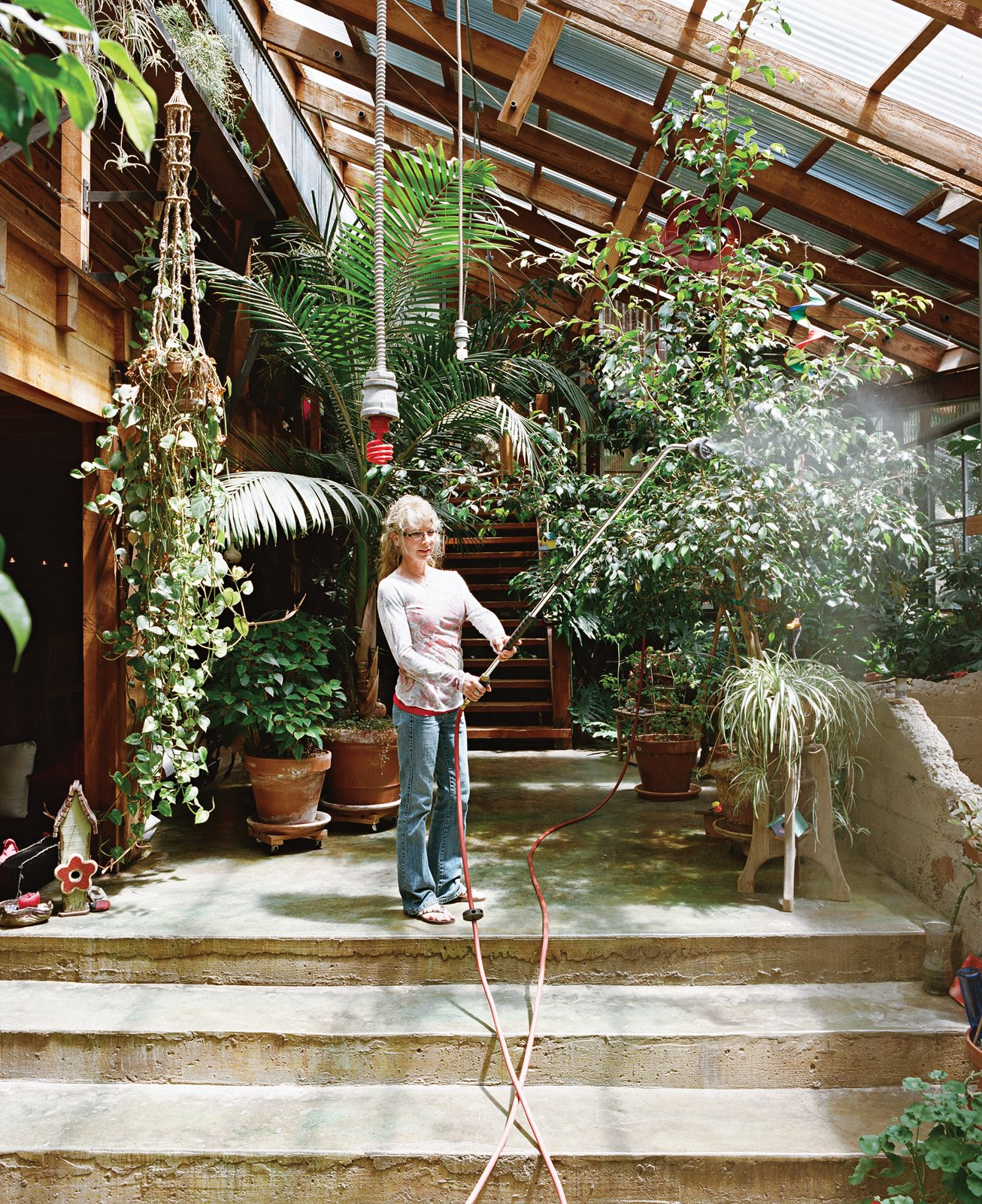 Outdoor and Gardens Sue waters the indoor foliage with an industrial hose hung from the ceiling.  Photo 5 of 13 in Diamond in the Rough (and Ready)