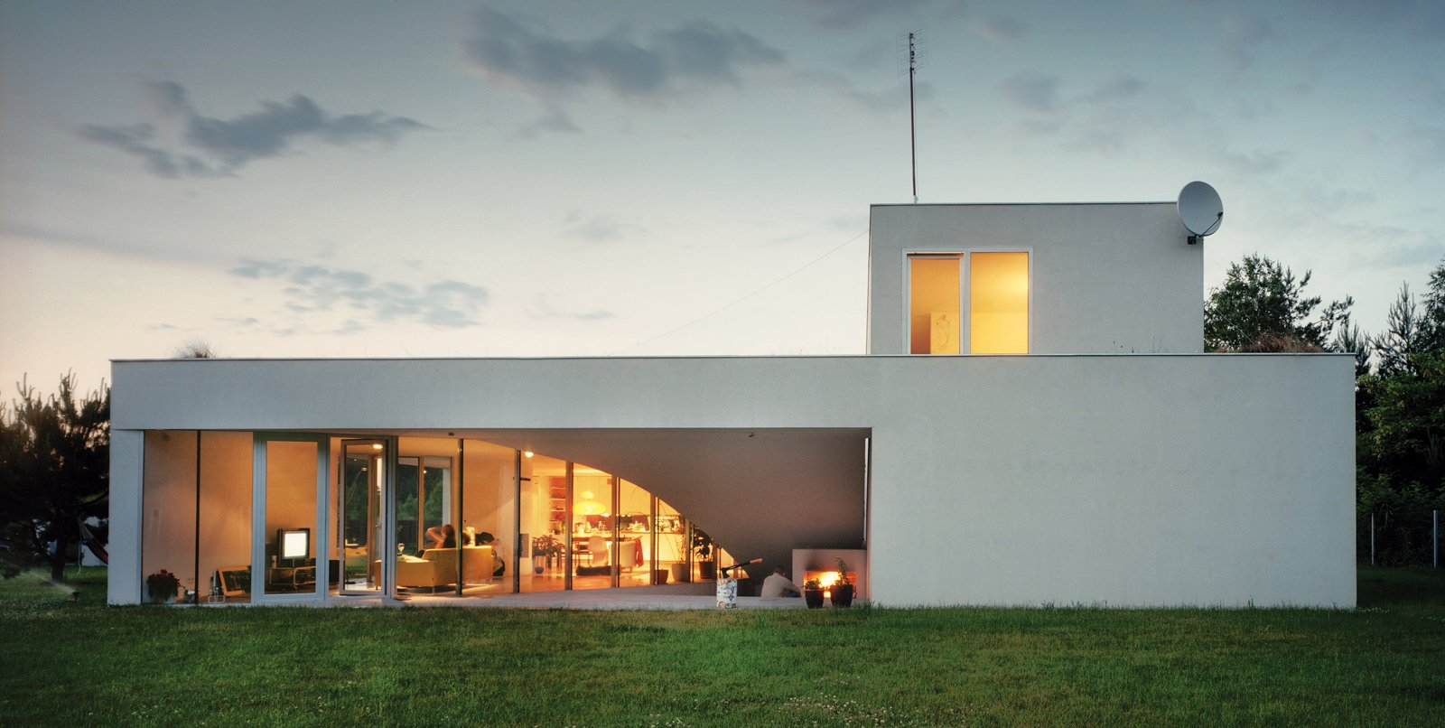 "Though the three-bedroom house is two stories, both floors offer ""front"" lawns on which to hang out, all accessible through sliding glass doors.  Photo 3 of 3 in Modernist Rural Getaway in Poland"