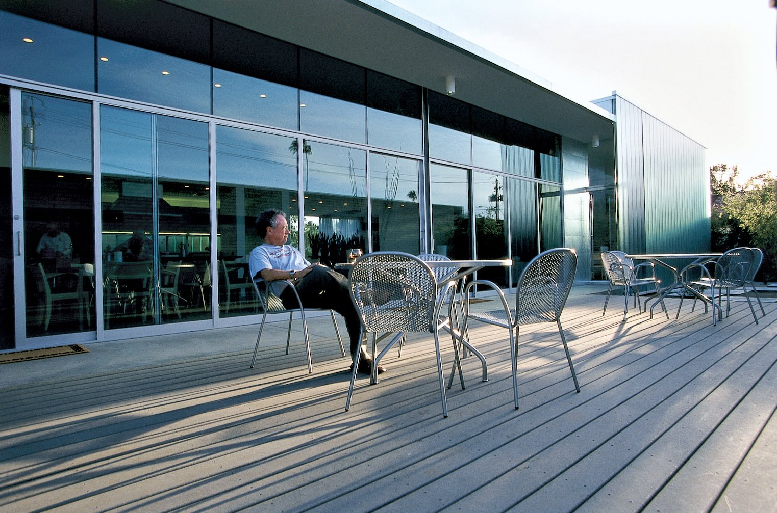 Ronde outdoor stacking chairs, from Design Within Reach, are situated on the deck off the living room.  Photo 3 of 6 in Houses of the Holy