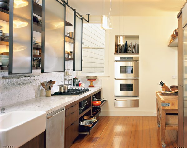 Prized possessions such as the old English butcher block sit cheek-to-jowl with 21st-century amenities, such as the stacking ovens by Dacor, six-burner Viking stove, and Miele dishwasher.