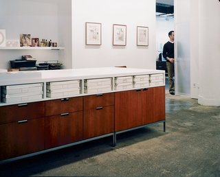 Florence Knoll credenzas, with laminate tops designed by the architects, form a unique work station in the office.