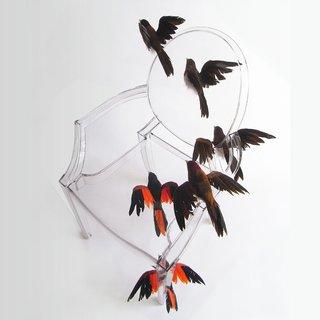 Reiko Kaneko's chair features a flock of birds in flight.