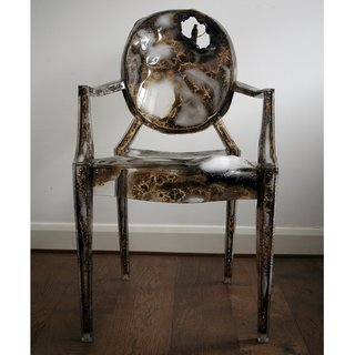 Kelly McCallum's burned chair, animated with a hummingbird.