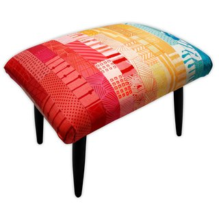 The Patchwork Footstool, which is covered in hand-dyed silk garnered from old wedding dresses.