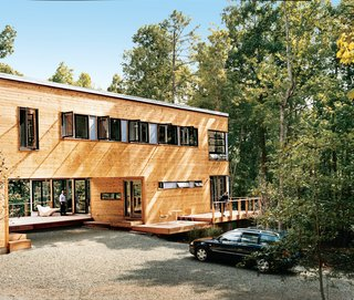 Wieler and Tung enjoy two of the home's several decks.The home is clad in red cedar siding and features a multitude of view-enhancing windows by Loewen. The decking is composite wood by Trex.