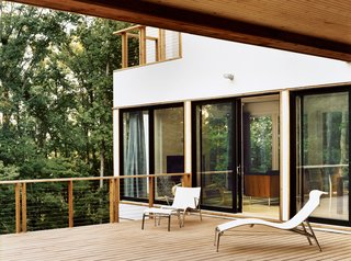 The private site allowed for generous windows and decks, but the Res 4 design could be adapted to <br><br>a more urban setting as well. Ultimately, the Dwell Home proves that a manufactured house can be site-specific. The design, scale, and materials are appropriate to the climate and context.