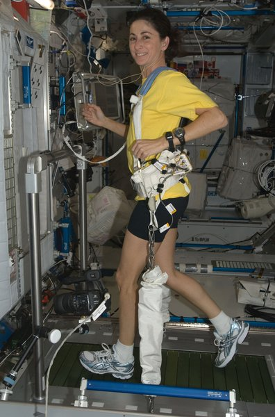 NASA astronaut Nicole Stott, Expedition 21 flight engineer, equipped with a bungee harness, exercises on the Combined Operational Load Bearing External Resistance Treadmill (COLBERT) in the Harmony node of the ISS. Photo taken October 20, 2009. Image courtesy of NASA.