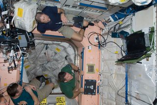 Members of the Space Shuttle Endeavour and ISS crews spend some rare leisure time together on the orbital outpost as they move within a day and half of undocking and going separate ways. Astronaut Sandra Magnus, flight engineer for Expedition 18, is partially visible at lower left corner. Others sharing a few moments in the Unity node, from the left, are cosmonaut Yury Lonchakov, Expedition 18 flight engineer, and astronauts Steve Bowen and Donald Pettit, both STS-126 mission specialists. Photo taken November 26, 2008. Image courtesy of NASA.
