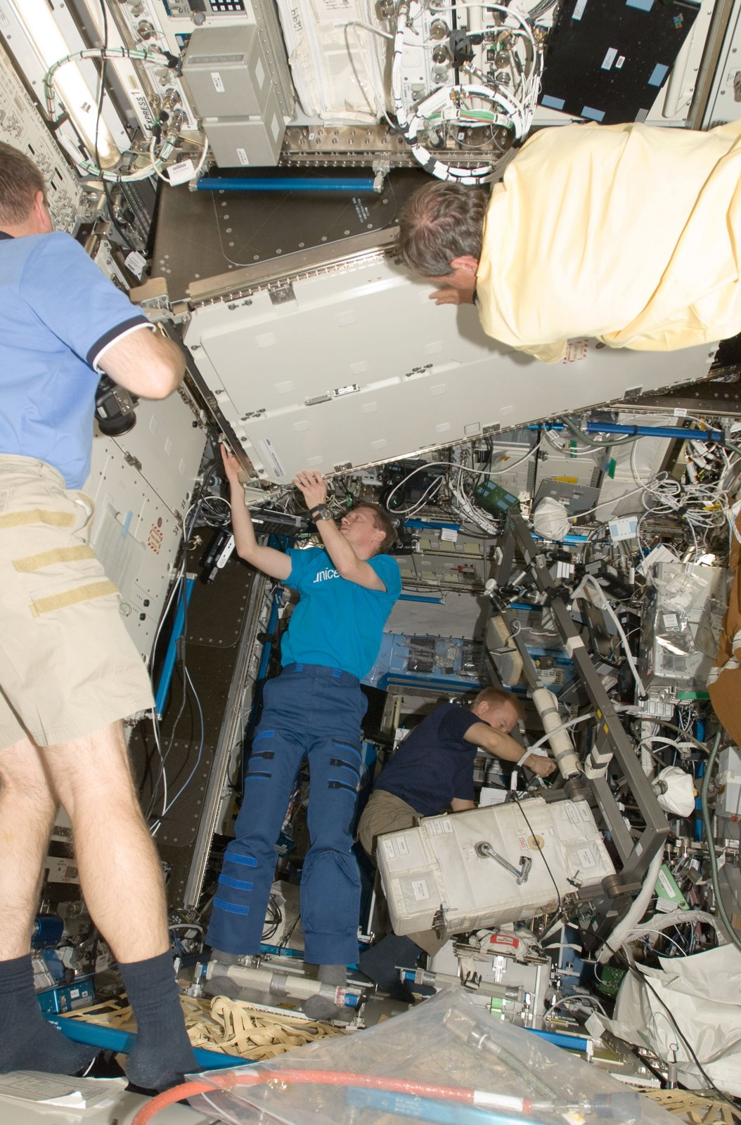 European Space Agency astronauts Christer Fuglesang (top foreground), STS-128 mission specialist; and Frank De Winne, Expedition 20 flight engineer, install a Materials Science Research Rack-1 (MSRR-1) in the Destiny laboratory of the ISS. NASA astronaut Kevin Ford (partially out of frame), STS-128 pilot; is at left; and NASA astronaut Tim Kopra, mission specialist, works in the background. Photo taken September 2, 2009.   Courtesy of NASA  Photo 19 of 32 in Space Living: Astro Home
