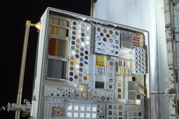 A close-up view of a Materials International Space Station Experiment (MISSE-6) on the exterior of the Columbus laboratory is featured in this image photographed by a space walking astronaut during the STS-128 mission's first session of extravehicular activity (EVA). MISSE collects information on how different materials weather in the environment of space. MISSE was later placed in Space Shuttle Discovery's payload bay for its return to Earth. A portion of a payload bay door is visible in the background. Photo taken September 1, 2009. Image courtesy of NASA.