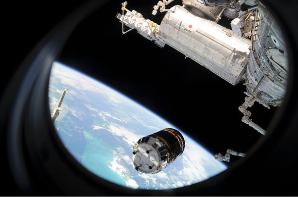 Backdropped by Earth's horizon and the blackness of space, the unpiloted Japanese H-II Transfer Vehicle (HTV) approaches the ISS. Once the HTV was in range, NASA astronaut Nicole Stott, Canadian Space Agency astronaut Robert Thirsk and European Space Agency astronaut Frank De Winne, all Expedition 20 flight engineers, used the station's robotic arm to grab the cargo craft and attach it to the Earth-facing port of the Harmony node. The attachment was completed at 5:26 (CDT) on Sept. 17, 2009. The Japanese Kibo complex (top right) and the Canadarm2 (bottom right) are also visible in the image. Photo taken September 17, 2009. Image courtesy of NASA.