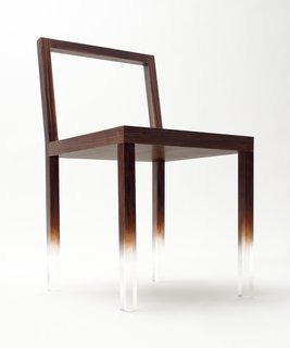 "The ""Fade-Out"" chair, a simple rectangular chair made from clear acrylic and painted with trompe l'oeil wood grain over most of the structure. The pattern fades away on the lower part of the chair legs to create the impression that the chairs are floating in space. Image courtesy Masayuki Hayashi."