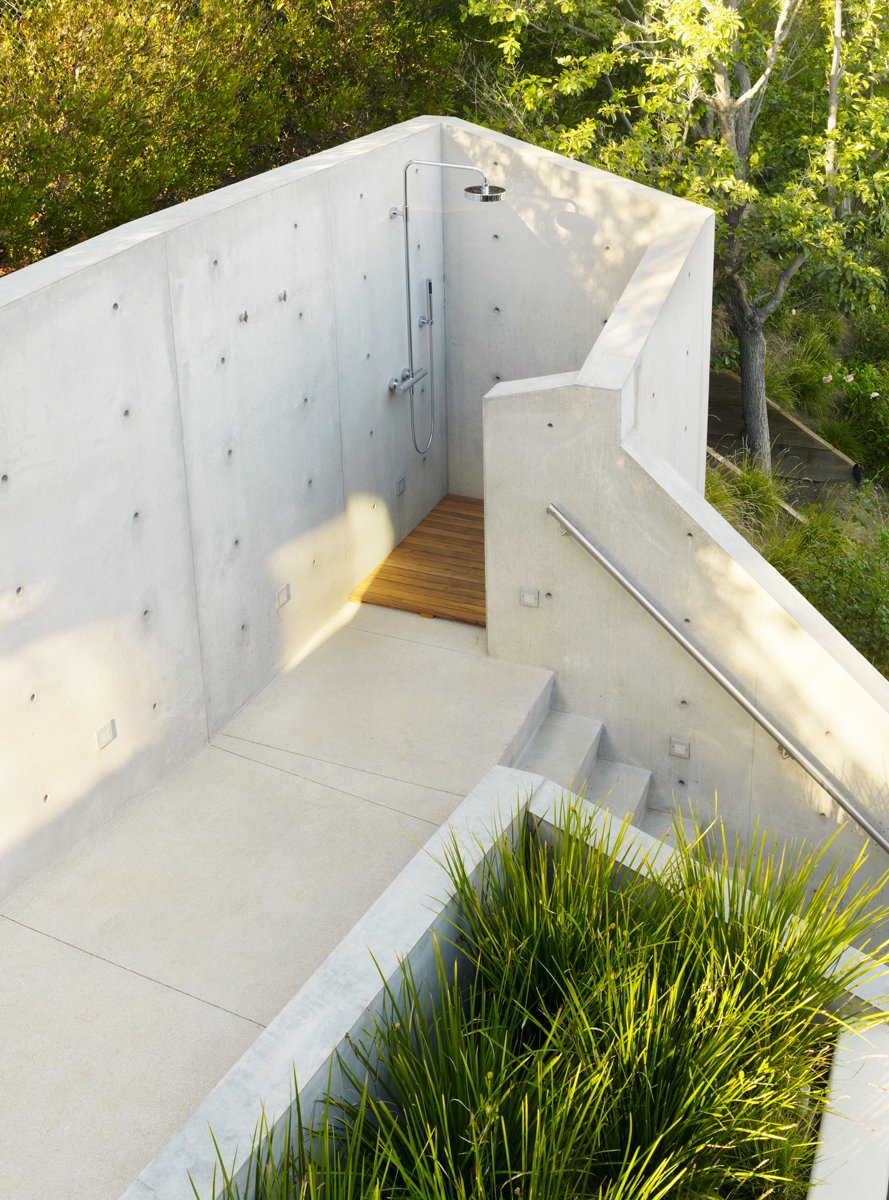 Outdoor, Large Patio, Porch, Deck, and Concrete Patio, Porch, Deck The outdoor shower below the treehouse was shaped and formed from concrete to be a truly private experience.  Photo 7 of 14 in These 13 Outdoor Showers Will Make You Consider One For Your Own Yard