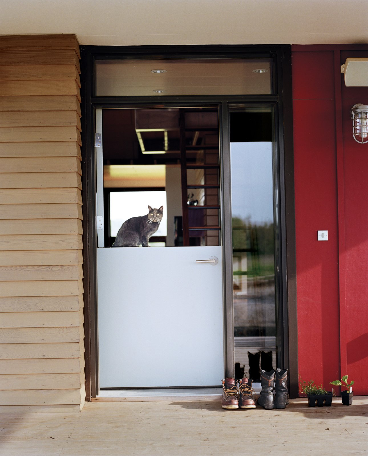 Doors, Swing Door Type, and Exterior Cultivating the land keeps the Moumings in a frequent rotation in and out of the house.   A Dutch door lets indoor and outdoor tasks flow together easily as they go about their day (with Yuri the cat standing guard).  Photo 9 of 10 in Farm Fresh