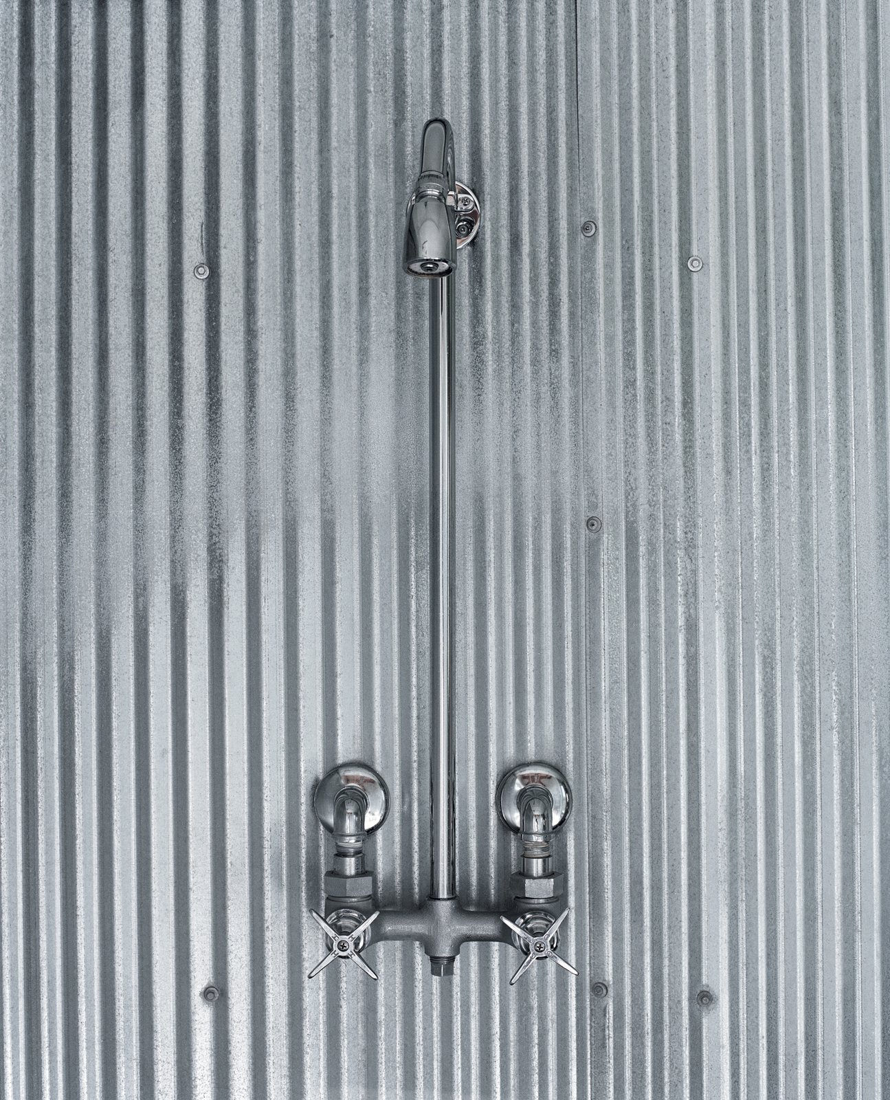 A simple shower design using corrugated steel references farmhouses of old.  Photo 6 of 10 in Farm Fresh