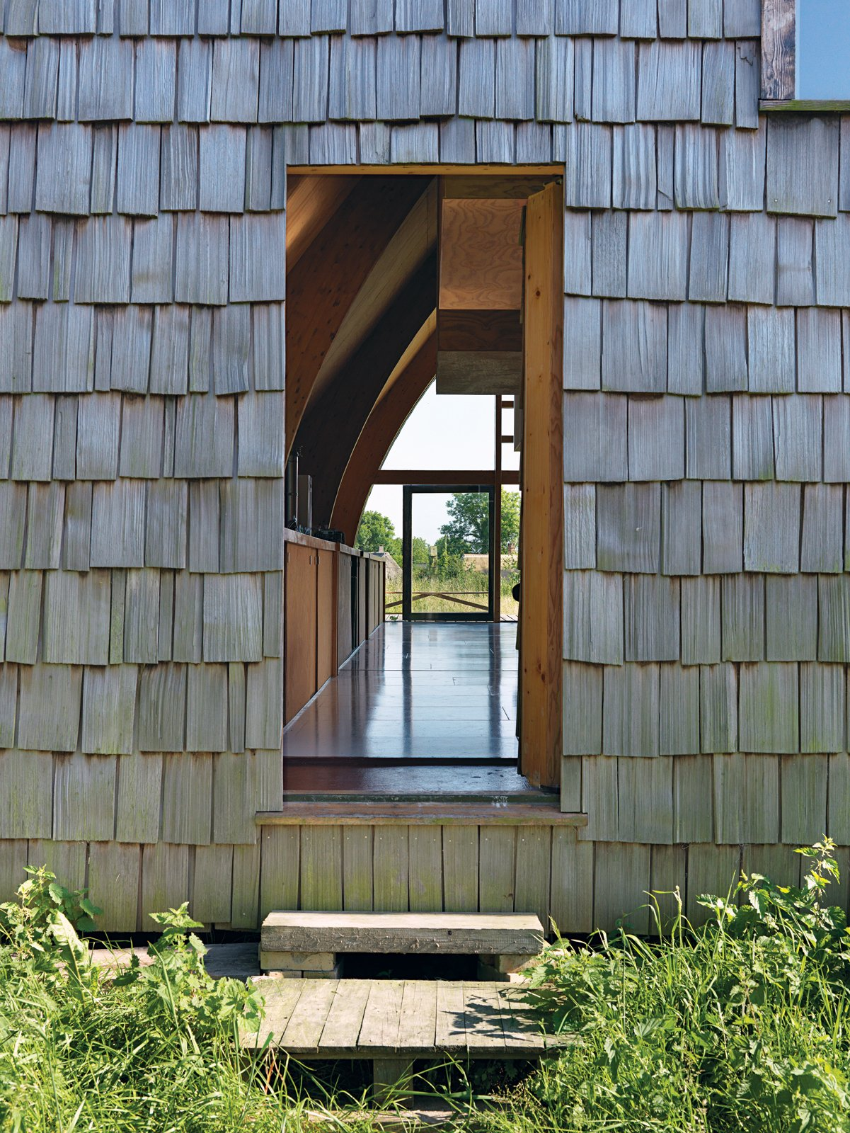 Doors and Exterior The front door dissolves into the facade.  Photo 11 of 11 in Modern Wooden A-Frame Retreat in France