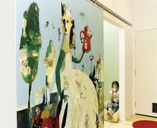 """The Lees commissioned local artist Blair Thornley to create a large painting, which Public then mounted on a slider. The painting now functions as a sliding door to close off the TV room when necessary. """"Blair coated it in acrylic,"""" architect James Gates explains, """"so they don't have to worry about handprints."""""""