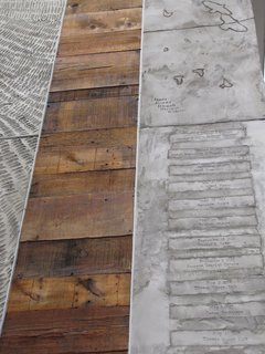 Engraved House - Photo 15 of 17 - The original floorboards accompany the stamped list of property owners.