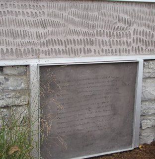 Instead of removing the old coal chute, Griffin printed the original deed to the property on a new concrete panel covering it.