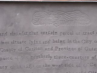 Engraved House - Photo 17 of 17 - Using an old typeface, the artist stamped the turn-of-the-century deed into the panel.