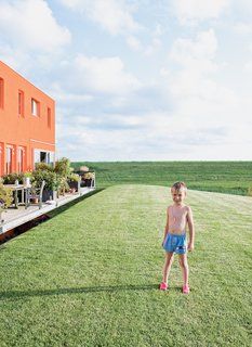 Five-year-old Thomas Dochter plays outside the houses.