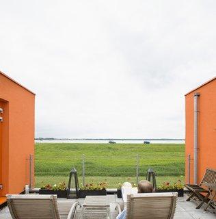 The nearby lake makes for a pretty setting, especially when framed by Villa Van Vijven's orange facade.