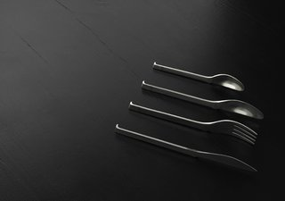 "Kilo Design + BIG + Skibsted Ideation - Photo 3 of 15 - Oki Cutlery by KiBiSi. Designed in 2007 to combine the idea of a chopstick rest (""hashi oki"") with Scandinavian cutlery design so the ends of the forks, spoons, and knives never touch the tabletop. In prototyping phase.<br><br>Photo courtesy of KiBiSi"