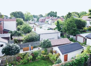 At the top, the view from the roof deck reveals a patchwork of garages and yards surprisingly free of neighbors.