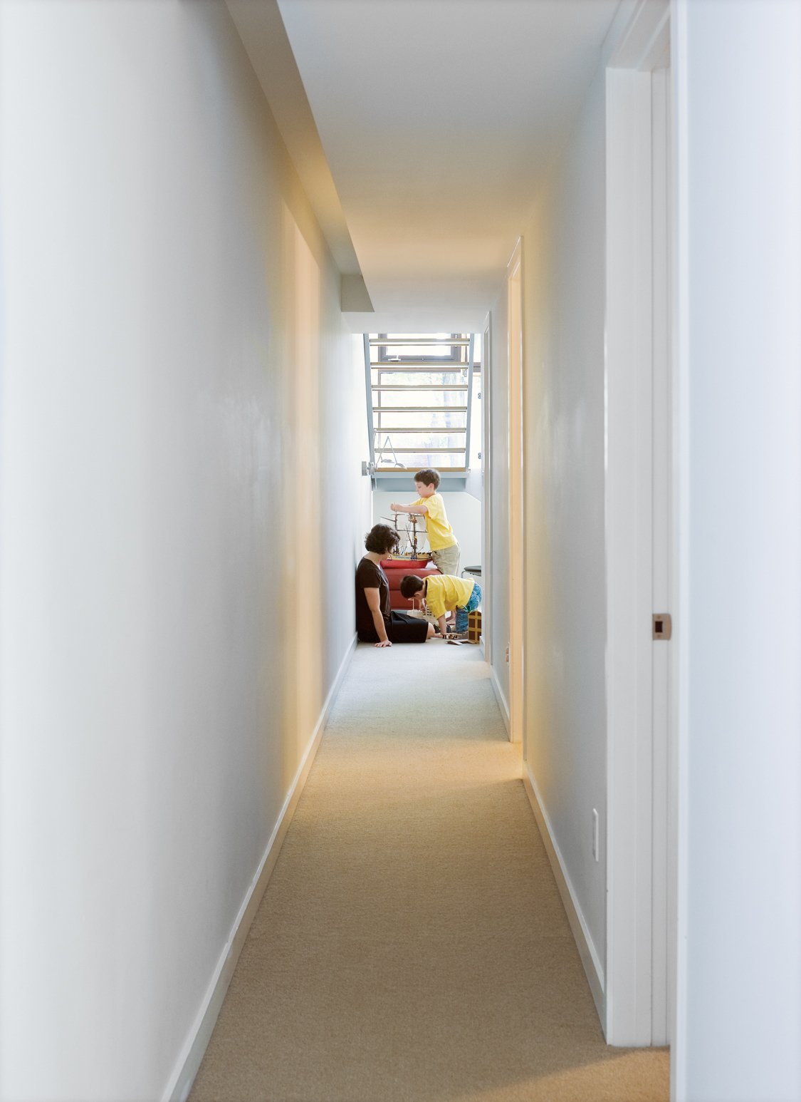 Hallway and Carpet Floor Down the corridor from the boys' bedrooms is the family room.  Photo 7 of 18 in Narrow Modernist Three-Story Home in Toronto