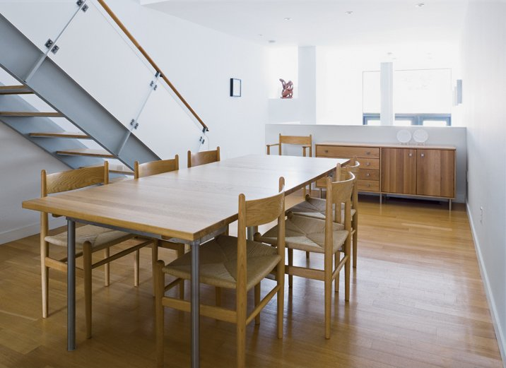 Dining Room, Chair, Table, Storage, Medium Hardwood Floor, and Recessed Lighting In the dining room, furniture by Wegner and local designers Speke Klein blends with the white oak floors and stair.  Photo 12 of 18 in Narrow Modernist Three-Story Home in Toronto