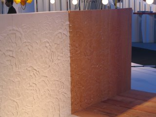 The headboard of the bed by Peter Marigold shows his flowery visual signature.