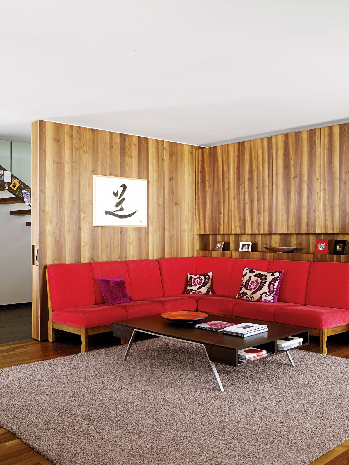 Living Room, Sofa, Coffee Tables, and Dark Hardwood Floor The red sofa in the living room is a 1960s piece originally owned by Strolz's parents.  Photo 1 of 8 in Snow Proofed Hillside Family Home in Austria