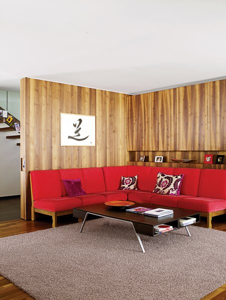 The red sofa in the living room is a 1960s piece originally owned by Strolz's parents.  Photo 20 of 21 in Red, Red, and More Red! 20 Bold Interiors That Make a Statement